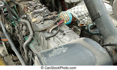 Mechanic Repairing Diesel Engine - Auto mechanic or driver...