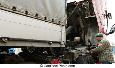 Truck Engine Repair - Auto mechanic or driver repairing...