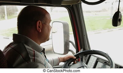 Truck Driver - Lorry driver at the wheel of truck