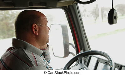 Truck driver on the phone - Lorry driver on the phone at the...