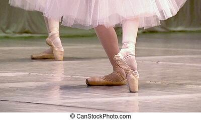 Choreography - Ballerinas do synchronous movement in dance
