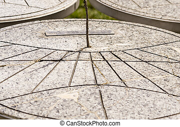 sundial on the marble table
