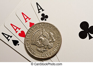 Four aces and coin - Four aces of a playing cards of poker