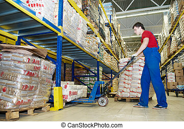 warehouse worker with forklift stacker