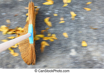 Sweeping the floor with moving motion over ground and leaves