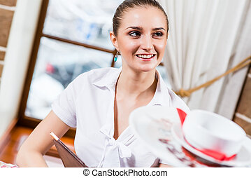 portrait of a nice lady at the restaurant