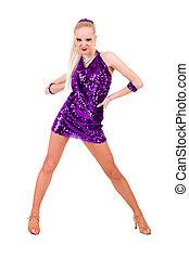 Full length of sensual woman in short dress dancing against...