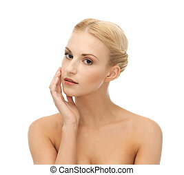 woman touching her face skin - portrait of beautiful woman...