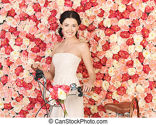 woman with bicycle and background full of roses - young...