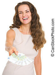 Closeup on fun of euros in hand happy young woman