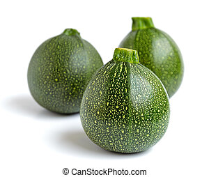 Three courgettes - Three round courgettes or zucchinis...