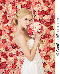 woman with bouquet and background full of roses - woman with...