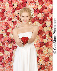 woman with heart and background full of roses - young woman...