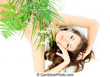 eternal youth - Beautiful young woman lying among fresh...