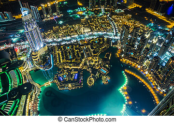 Dubai downtown night scene with city lights, - DUBAI, UAE -...