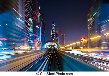 Dubai metro railway in motion blur - DUBAI, UAE - NOVEMBER...