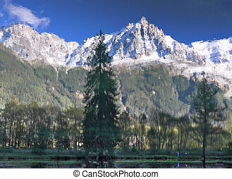 Reflections of snow-capped peaks - Chamonix - a famous ski...