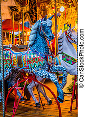 Carousel. Horses on a carnival Merry Go Round. - Vintage...