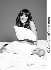 Smiling woman in lingerie in the bed - photo of smiling...