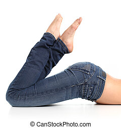 Close up of a beautiful woman legs with jeans and barefoot...