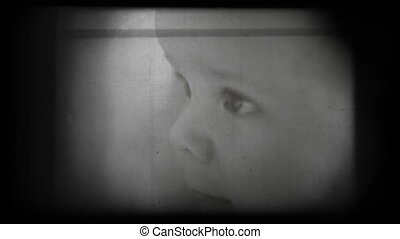 Happy baby portrait, vintage 8mm film footage