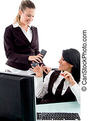 executive taking phone receiver from her secretary in office