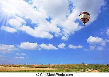 Scenic hot air balloon in free flight Gorgeous day in April...
