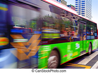 High speed and blurred bus trails on downtown road