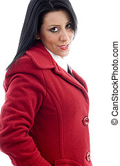 attractive young female in overcoat on an isolated white...