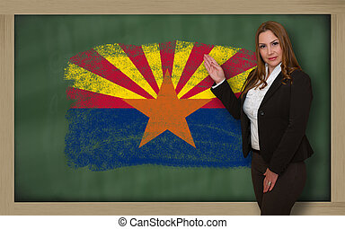 Successful, beautiful and confident woman showing flag of...