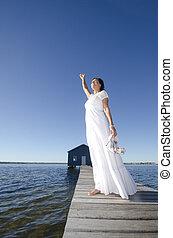 Portrait happy mature bride at sea - Portrait attractive...