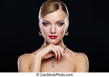 High fashion look.glamor closeup portrait of beautiful sexy Caucasian young woman model with red lips,bright makeup, with jewelery with perfect clean skin isolated on black