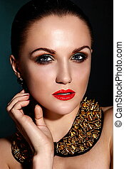 High fashion look.glamor closeup portrait of beautiful sexy brunette Caucasian young woman model with healthy hair,bright makeup, with red lips,  with perfect clean skin with accessory jewelery