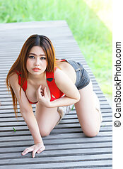 Young beautiful Asian woman in red lingerie
