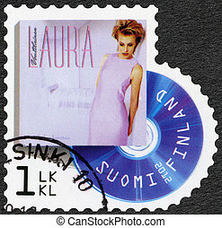 FINLAND - CIRCA 2012: A stamp printed in Finland shows Laura Voutilainen, series on Finnish music has reached the 1990's, circa 2012