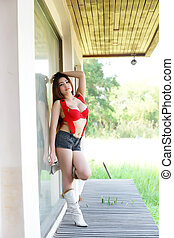 Young beautiful Asian woman in red lingerie voluptuous...
