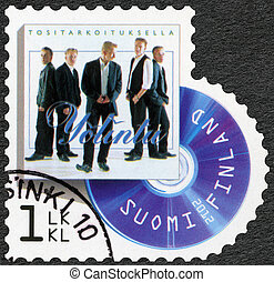 FINLAND - CIRCA 2012: A stamp printed in Finland shows band Yolintu, series on Finnish music has reached the 1990's, circa 2012