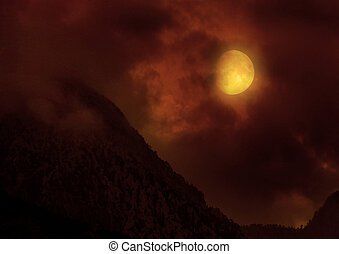 night landscape - The moon in the night sky in clouds...