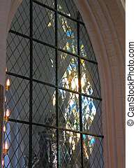 Church Stained Glass Window with Light Reflection