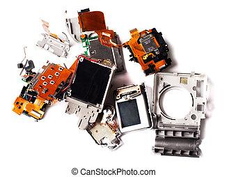 Broken compact digital camera parts prepared.