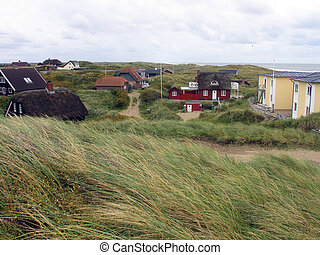 Traditional Danish summer houses with straw roofs in the...