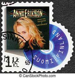 FINLAND - CIRCA 2012: A stamp printed in Finland shows Anna Eriksson, series on Finnish music has reached the 1990's, circa 2012