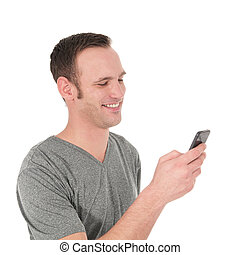 Happy young man reading a text message