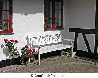 Garden bench in the backyard - White traditional wooden...