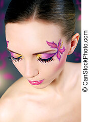 Face art - Girl with beautiful makeup. black background