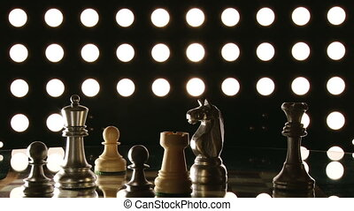 Chess pieces, round lights in the background