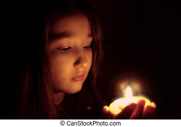 The true moment - Portrait of the girl with a candle in...