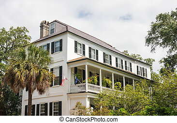 White House with Veranda on Second Floor - A white two story...