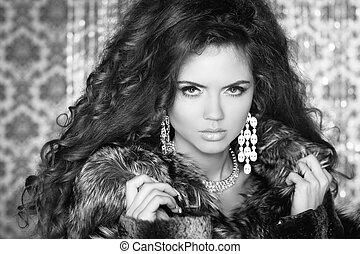 Beautiful Woman in Luxury Fur Coat. Black and white photo