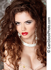 Glamour portrait of beautiful woman model with evening make up and curly hair. Fashion and Jewelry.
